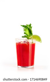 Bloody Mary cocktail on a white background. Tomato juice, lime, and celery, side view