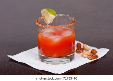 Bloody Mary Cocktail with salt  lime and nuts