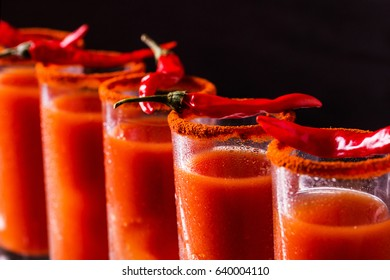Bloody Mary cocktail with spicy smoked ground chili pepper, ice and celery.