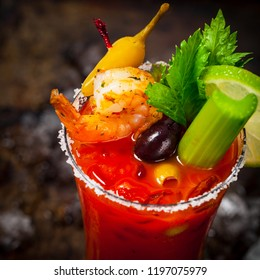 Bloody Mary Cocktail with Vodka and Tomato Juice, Tabasco Sauce and Ice Decorated with Shrimp and Celery. Selective focus.