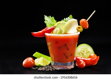 Bloody mary, a red drink based on vodka, tomato juice, lemon juice, celery, peas, Worcestershire sauce, tabasco and pepper, on a black background