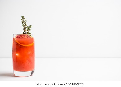 Bloody oranges beverage with thyme. Selective focus. Shallow depth of field.