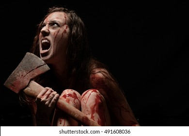 Bloody Scary Girl holding an axe