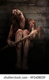 Bloody Scary Girl Screaming holding an axe