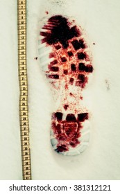 Bloody shoe print in the snow in Finland. Staged crime scene photo. Also shown a yellow tape measure. Image includes a vintage effect.