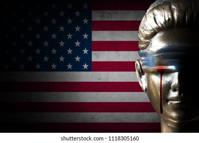 Bloody tear of Lady Justice on U.S.A. flag background (Concept of injustice)