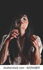 Bloody Woman choking on blood