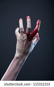 Bloody zombie hand, extreme body-art, studio shot