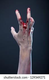 Bloody zombie hand, studio shot