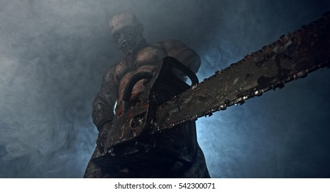 Bloody zombie killer with a chainsaw is in the dark and smoke. Horror.
