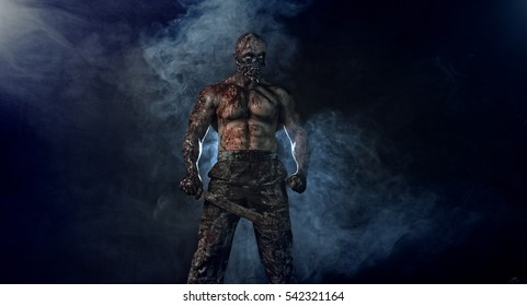 Bloody zombies killer is on the black background of the smoke with a machete. Horror.