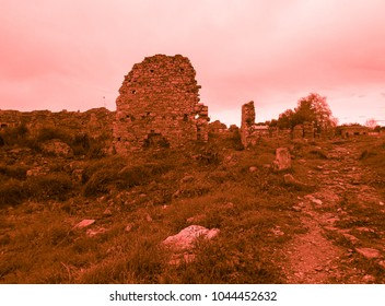 Bloody-red colored ruins of ancient Side
