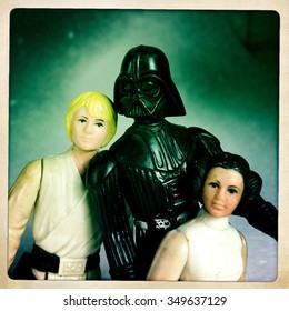 BLOOMFIELD, NEW JERSEY - JUN 17 2012: Filtered image of a Father's Day concept of Darth Vader and his offspring, Luke Skywalker and Princess Leia.