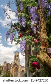 blooming York 2018 part of a display of flowers on a building with St Helen's  church in the background.