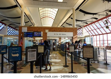 Bloomington, IL/USA-8/22/19: People going through TSA security screening a busy international airport.