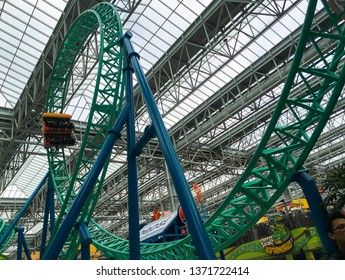 BLOOMINGTON, MINNESOTA - APRIL 13, 2019: The SpongeBob SquarePants Rock Bottom Plunge roller coaster thrill ride enters its first loop at Nickelodeon Universe in the Mall of America.