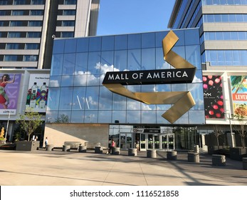 Bloomington, MN /June 7, 2018: Exterior of the entrance of Mall of America, a major tourist destination in Minnesota. Clouds show up in the reflection in the windows.