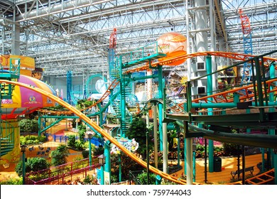 Bloomington, MN, USA May 14, 2013 Multiple rollercoasters vie for space and thrills at the Nickelodeon Universe, the largest indoor Amusement Park, at the Mall of America in Bloomington, Minnesota