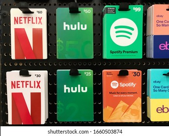 Bloomington, MN/USA. February 28, 2020. Various gift cards on display for streaming video and music streaming services.