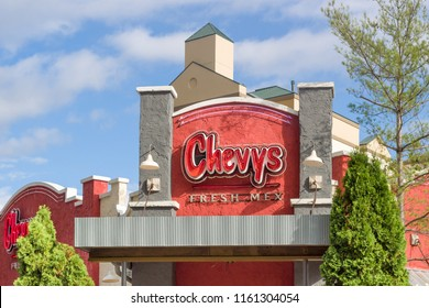 BLOOMINGTON, MN/USA - July 26, 2018: Chevys Fresh Mex restaurant exterior and logo. Chevys Fresh Mex is an American chain of Mexican-style casual dining restaurants located in the United States.