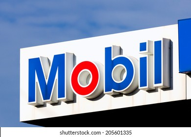 BLOOMINGTON, MN/USA - JUNE 22, 2014: Mobil gas station facade and logo. Mobil is a major American oil company which merged with Exxon in 1999 to form ExxonMobil.