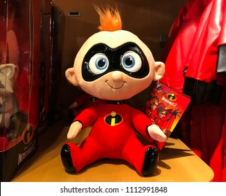 Bloomington, MN/USA- June 7, 2018. A retail display featuring a toy from Incredibles 2 named Baby Jack Jack. Kids superhero outfits hang nearby.