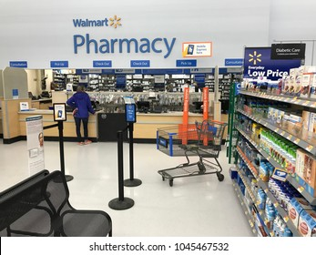 Bloomington, MN/USA- March 12, 2018. Interior shot of the pharmacy at Walmart. A customer waits for a pickup.