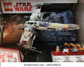 Bloomington, MN/USA. May 2, 2019. A Lego X-Wing Star Fighter on display with Luke Skywalker and robot R2-D2 figure in front.