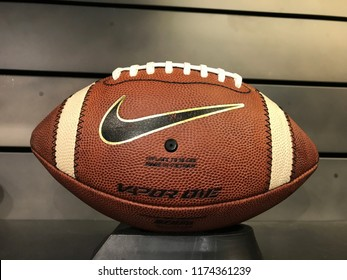 Bloomington, MN-USA- September 5th, 2018. A football on display at The Nike Store at the Mall of America. Nike has been trending in the news with their new campaign featuring Colin Kaepernick.