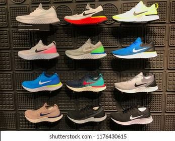 Bloomington, MN-USA- September 5th, 2018. A multi-colored wall of shoes at The Nike Store at the Mall of America. Nike has been trending in the news with their new campaign featuring Colin Kaepernick.