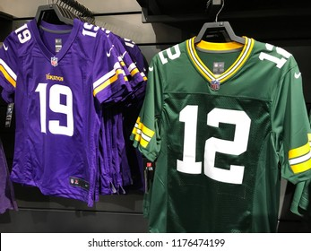 Bloomington, MN-USA- September 5th, 2018. Jerseys for Packers QB Aaron Rodgers and Vikings WR Adam Thielen on display at the Nike Store at the Mall of America. The rival teams face off this week.