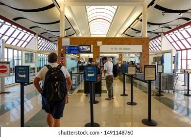 Bloomington,IL/USA-8/25/19: Person going through TSA Precheck line and regular line through airport security.