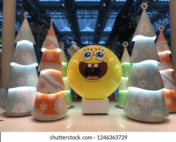 Bloomington,MN/USA. December 1st, 2018. An interior view at Mall of America featuring a holiday scene with orange and blue lit Christmas trees and a giant SpongeBob Squarepants ornament.