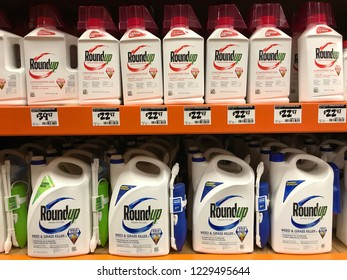 Bloomington,MN/USA- November 11,2018. A display of many Roundup weed and grass killer containers in a retail store. Roundup has been trending in the news based on recent lawsuits against it.