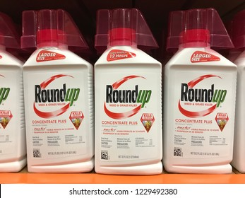 Bloomington,MN/USA- November 11,2018. Roundup weed and grass killer bottles on display in a retail store. Roundup has been trending in the news because of lawsuits alleging that it causes cancer.