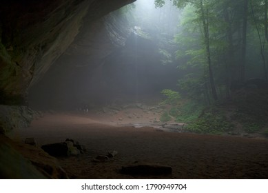 BLOOMINGVILLE, OHIO -JUNE 19, 2011: A foggy day at Ash Cave in Hocking Hills, Ohio featuring a small waterfall