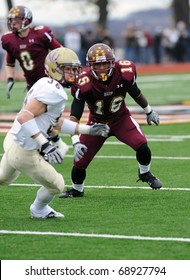 BLOOMSBURG, PA - NOVEMBER 6: Bloomsburg University defensive back Vince Browning (#16) covers a Kutztown receiver running a pass route in a football game November 6, 2010 in Bloomsburg, PA