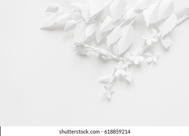 Blossoming branch of cut white paper on white background. spring