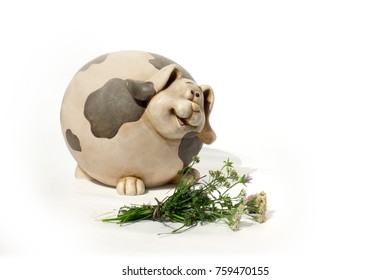 blossoming flower and ceramic pig