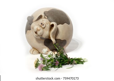 blossoming flowers and ceramic pig