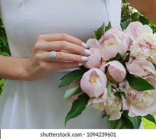 Blossoming peonies bouquet engagement ring