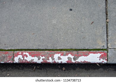 Blotchy Red and White Painted Curb