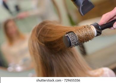 blowdrying the hair