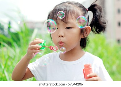 Blowing bubbles in the park for children