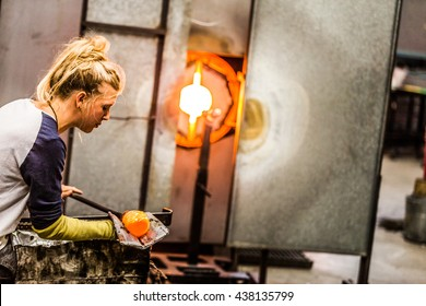 Blowing Glass Professional Caucasian Woman Working on a Vase.