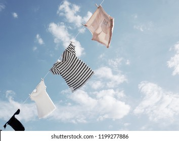 Blowing Hung outdoor to dry cloths in the bright sky and warm sun