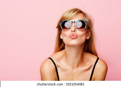 Blowing kiss babe in sunglasses, portrait