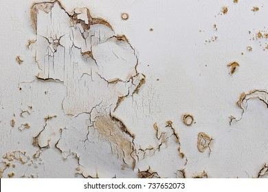 Blown plaster on an old internal wall. Damaged damp plasterwork in need of repair. House renovation and building work.