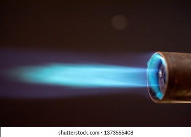 blowtorch torch burner blue flame, Industrial gas burner, against black,  close up