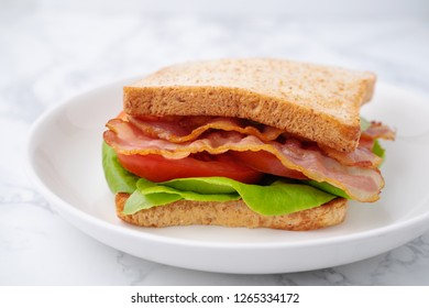 BLT Sandwich with Bacon Lettuce and Tomato on white dish, Homemade meal and fast food.